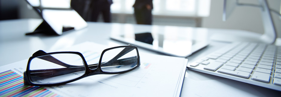 Technological devices, eyeglasses and financial document at work